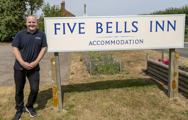 Mark Cooper and Five Bells sign